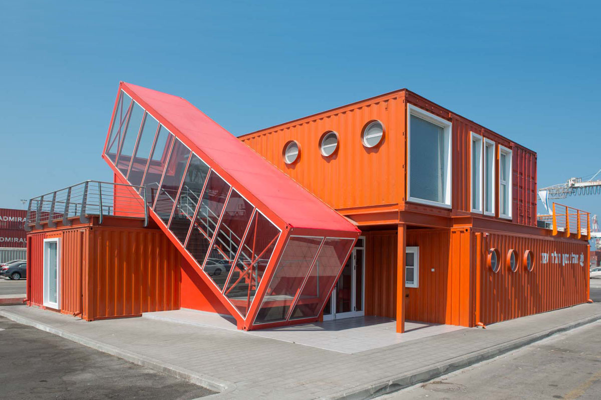 Angled shipping container houses a scissor staircase for House builder